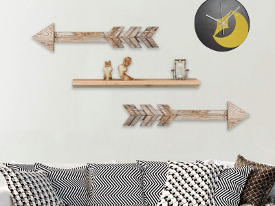 Arrows made out of wood hanging on a wall