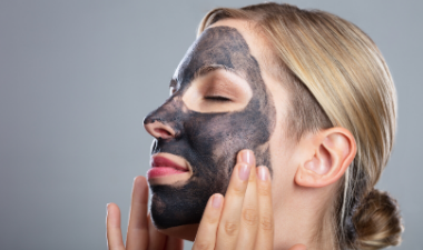woman with a charcoal face mask