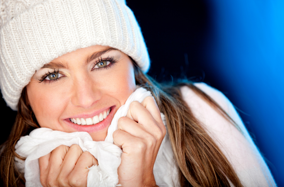 woman in hat and scarf smiling