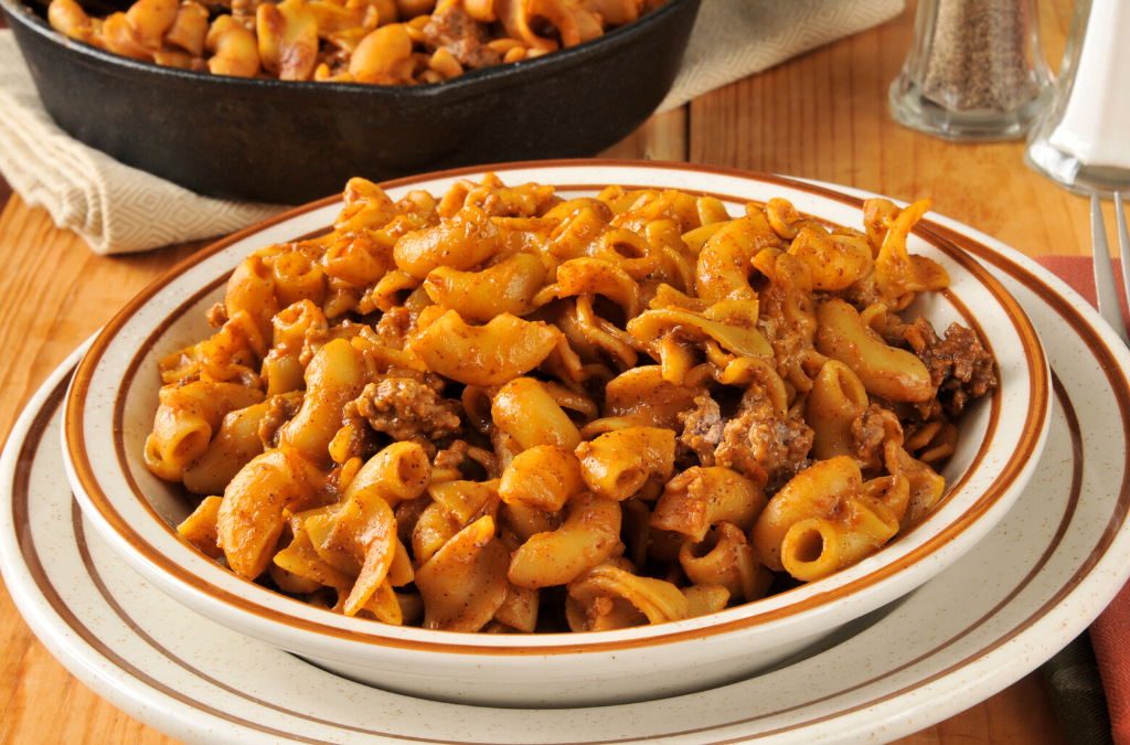 a bowl of ground beef and pasta with cheese