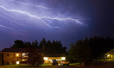 photo of lightning over a house