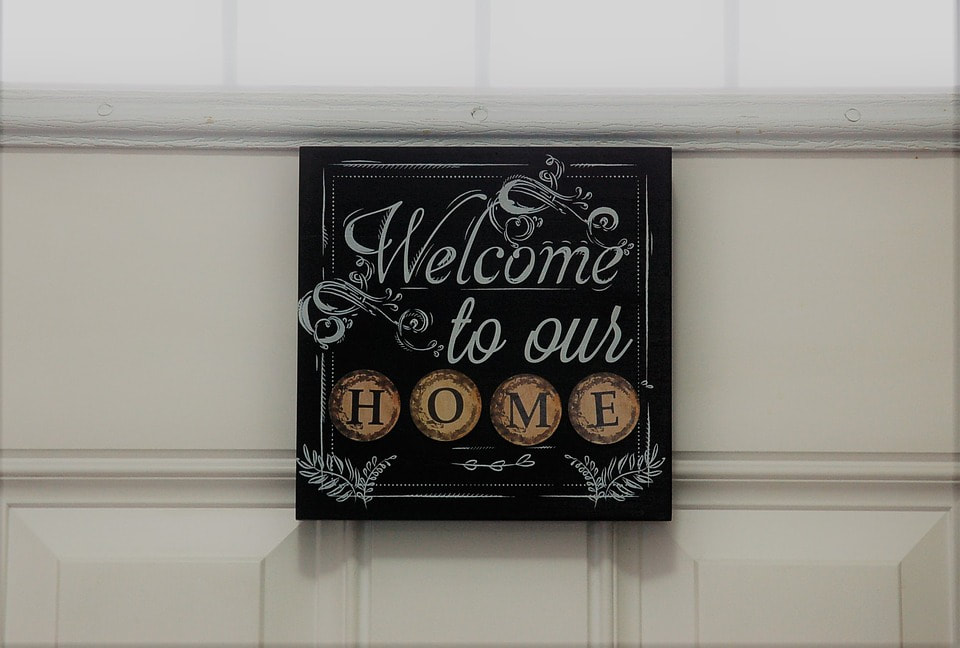Photo of a sign that says welcome to our home