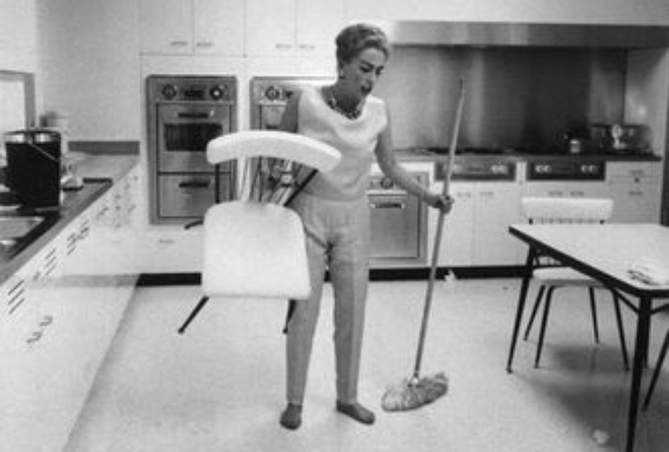Joan Crawford cleaning her kitchen