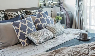 Photo of a blue and gray bedroom